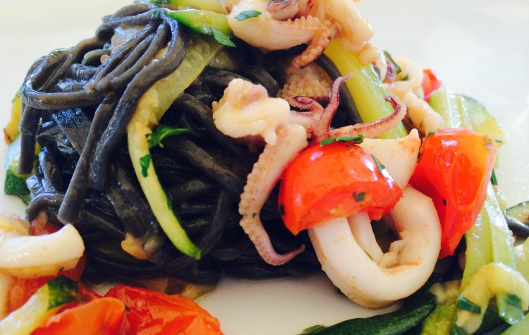 Black pasta made with squid ink and seafood