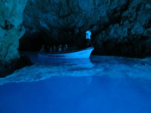 Boat entering the Blue Cave of Biševo Island, Croatia