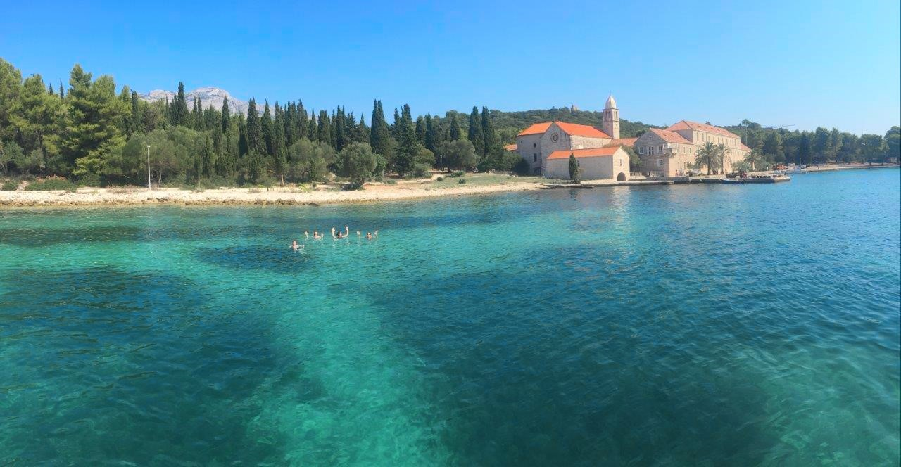 Happy sailors swimming off the island of Korcula Croatia