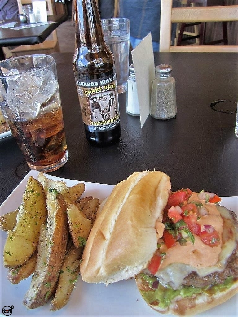 Delicious Red Rock Burger with seasoned fries and Sarsaparilla soda at Burr Trail Grill