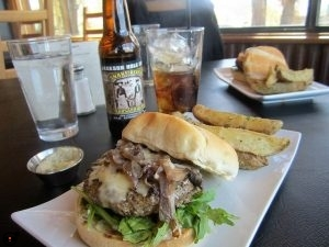 Delicious Mushroom Melt Burger with seasoned fries at Burr Trail Grill