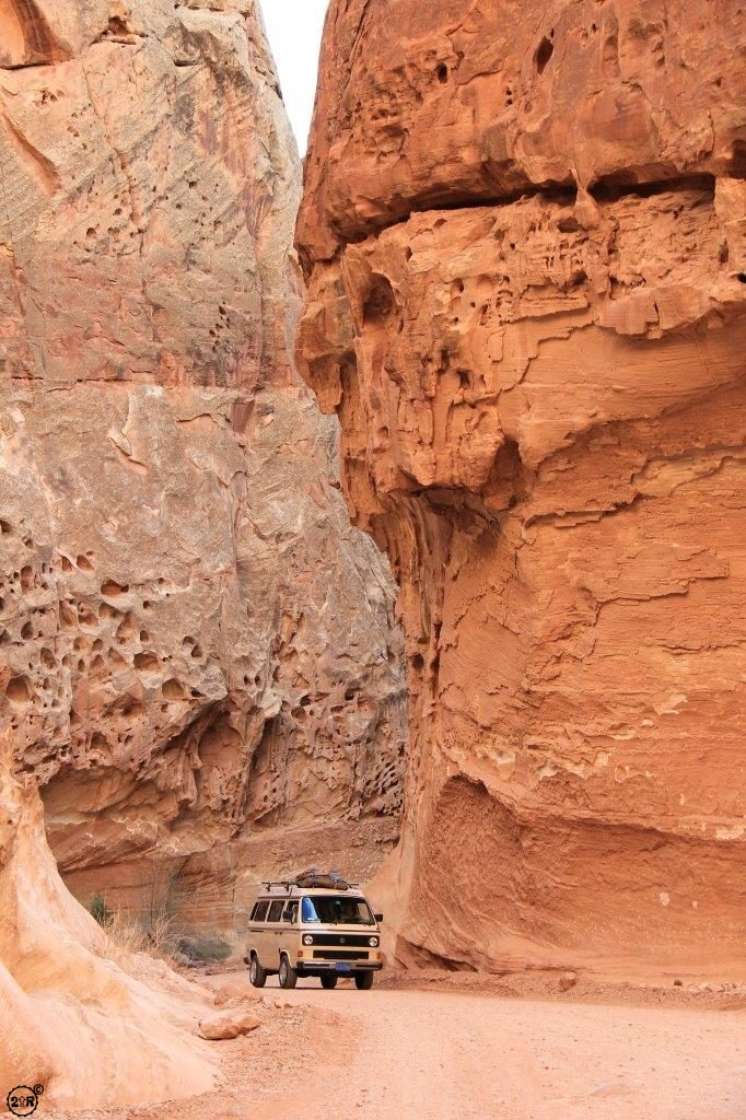 The high cliff walls and our VW Bus for scale during a 2011 trip to Capitol Reef