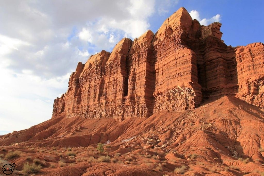 Light hitting the high cliff sandstone walls along the scenic drive in Capitol Reef