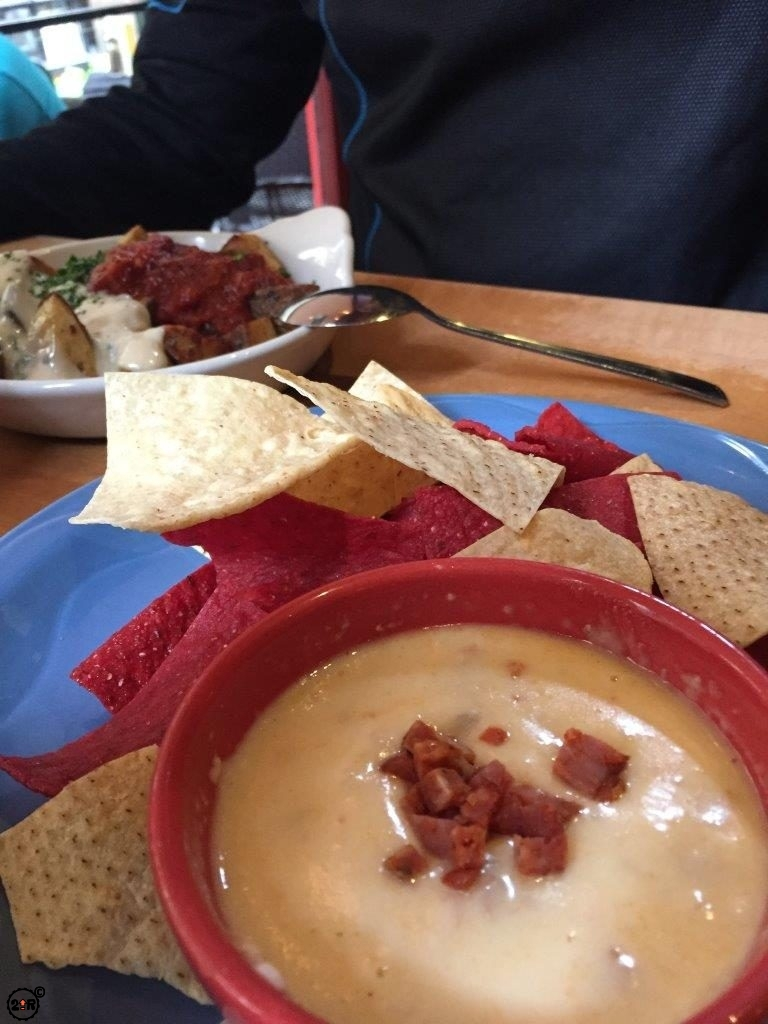 "Tortilla chips and chorizo ""fondue"""